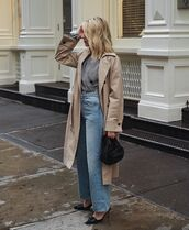coat,trench coat,double breasted,high waisted jeans,wide-leg pants,mules,black bag,wrap top