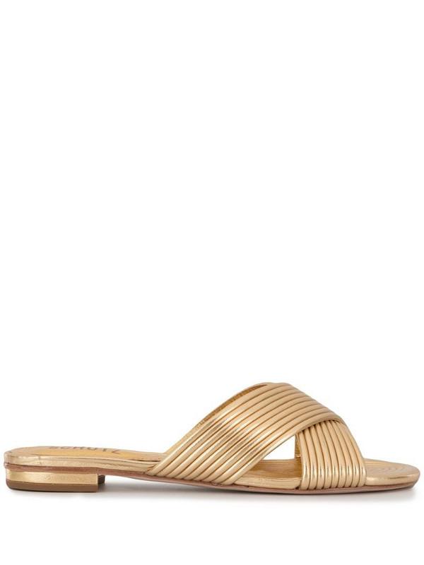 Schutz metallic cross-over sandals in gold