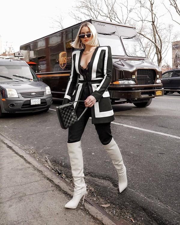 jacket blazer black and white balmain over the knee boots white boots heel boots black pants black bag chanel bag lace bodysuit