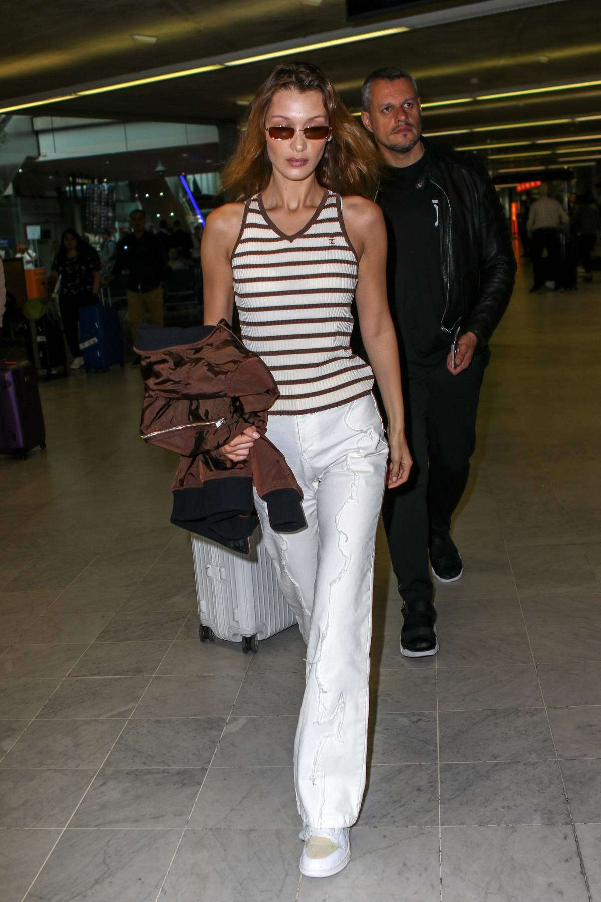 top white brown stripes striped top celebrity bella hadid model off-duty pants