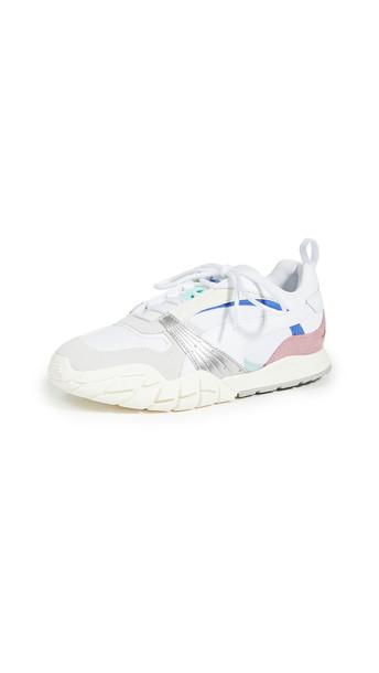 PUMA Kyron Awakening Sneakers in white