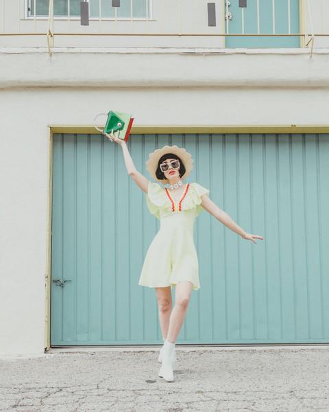 a fashion nerd blogger romper hat jewels sunglasses bag