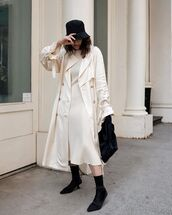 coat,trench coat,white coat,long coat,midi dress,white dress,black boots,sock boots,black bag,bucket hat