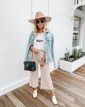 top,white t-shirt,wide-leg pants,denim jacket,black bag,ysl bag,mules,sun hat