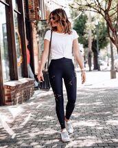 pants,black leggings,high waisted jeans,white sneakers,black bag,white t-shirt