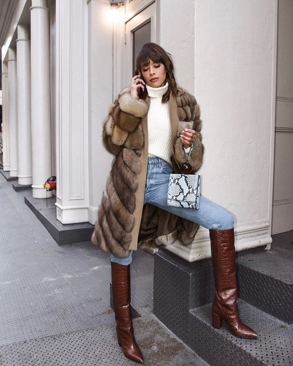 coat faux fur coat white turtleneck top high waisted jeans knee high boots bag