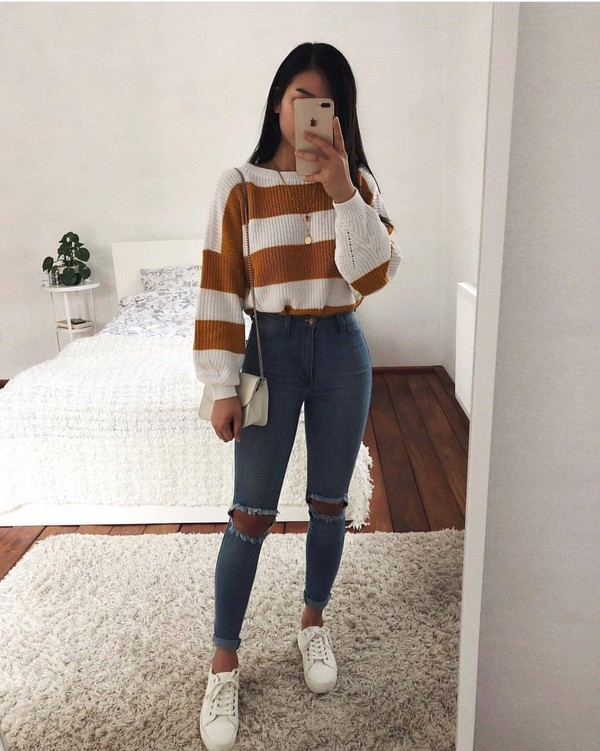 top little baggy white orange striped top long sleeves shirt sweater looking for this striped sweater r cropped sweater winter outfits winter sweater knitted sweater knitwear stripes knit jumper jeans ripped jeans blue jeans yellow