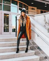 coat,faux fur coat,brown coat,ankle boots,heel boots,black leggings,black sweater,knitted sweater,knit,hat