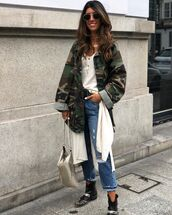 jacket,army green jacket,ripped jeans,ankle boots,black boots,white top,bag,cardigan