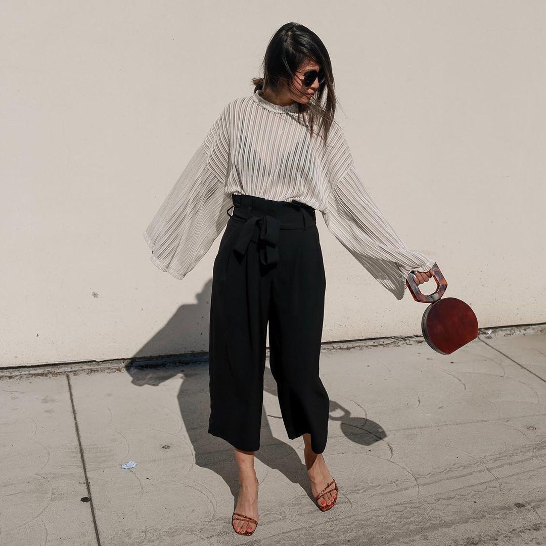 pants black pants wide-leg pants white sweater sandal heels handbag