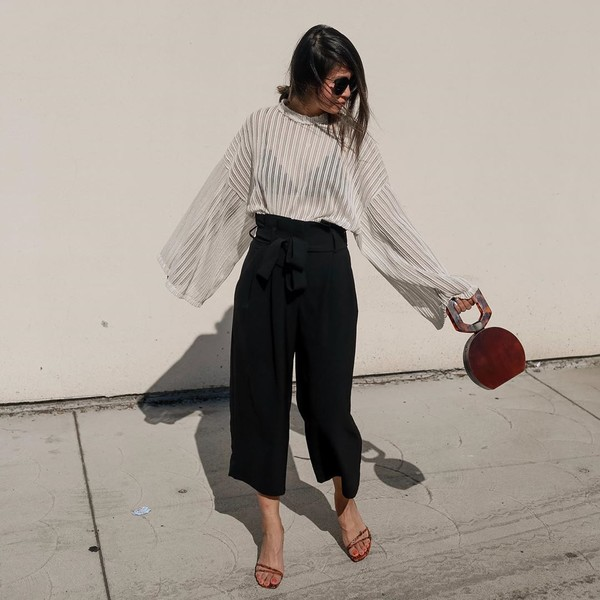 pants black pants wide-leg pants white sweater sandal heels handbag