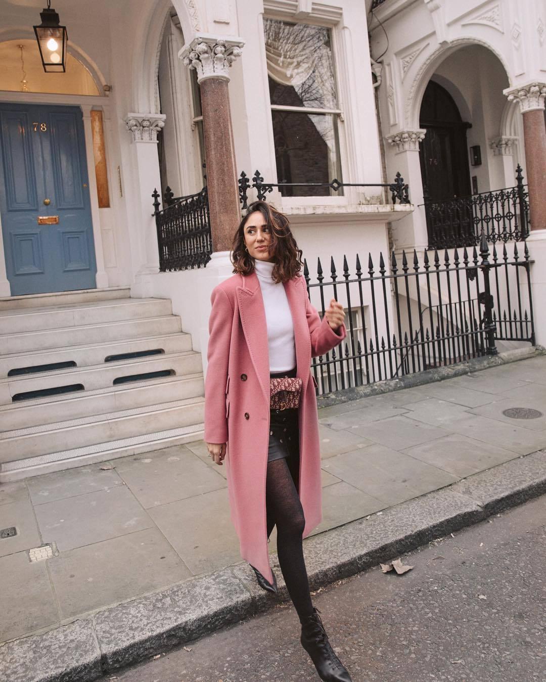 coat pink coat double breasted long coat black boots lace up boots tights black skirt pink bag belt bag white turtleneck top