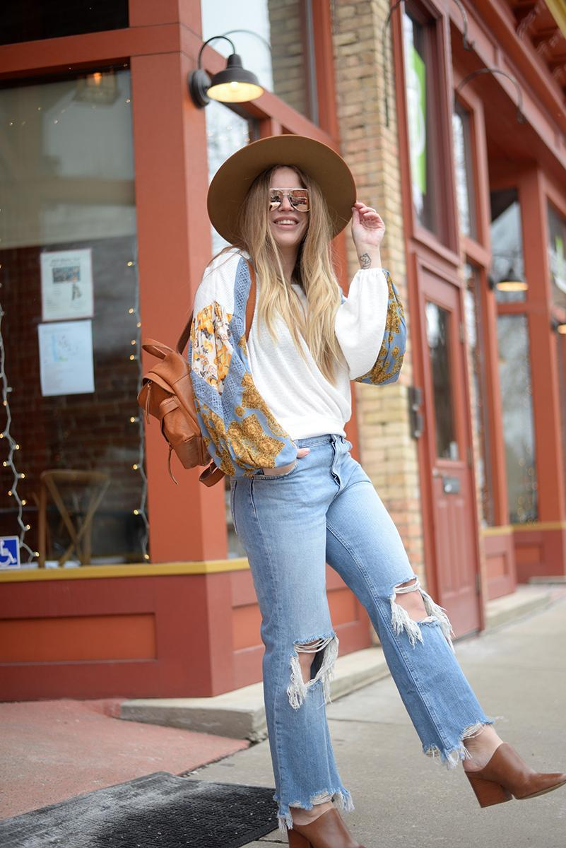 blonde bedhead blogger top sunglasses jeans hat ripped jeans backpack spring outfits