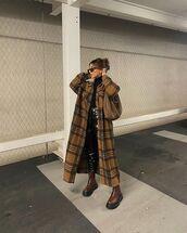 coat,long coat,plaid,brown boots,flat boots,black vinyl pants,black turtleneck top,bag
