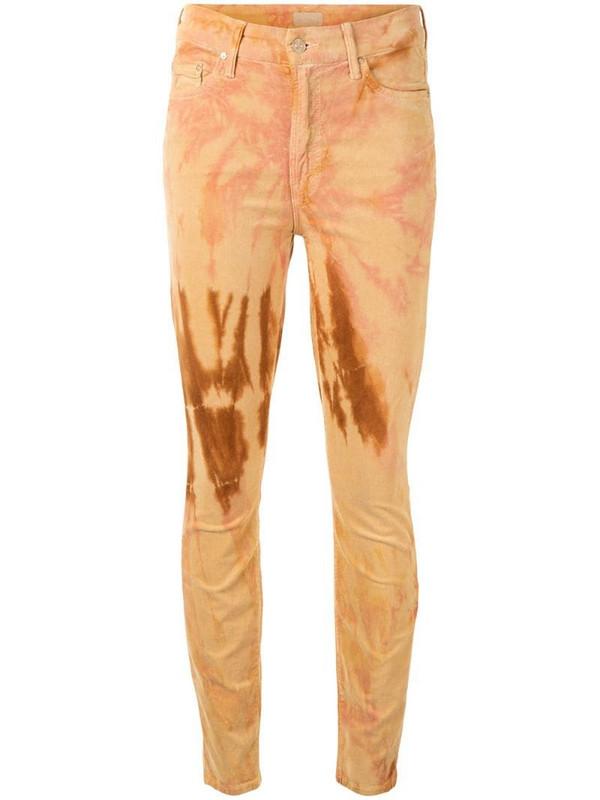 Mother tie-dye skinny jeans in orange