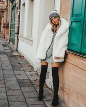 coat,faux fur coat,white coat,black boots,over the knee boots,knitted dress,grey dress,beanie