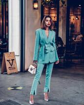 pants,pleated,slit pants,blue pants,blazer,pumps,handbag,white bag,necklace