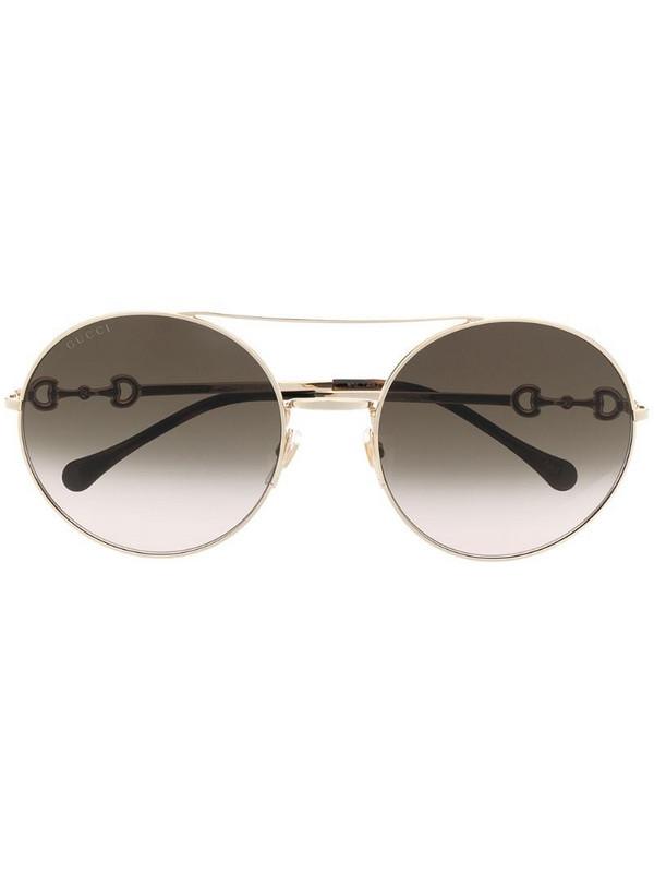 Gucci Eyewear round frame horsebit detail sunglasses in gold