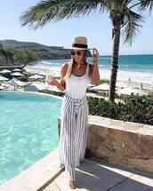 pants,striped pants,white swimwear,one piece swimsuit,hat,beach