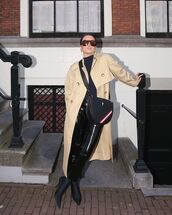 bag,black bag,black boots,crossbody bag,sock boots,black vinyl pants,beige coat,long coat,sweatshirt,trench coat