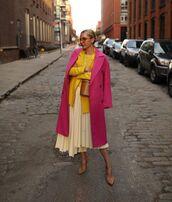 skirt,pleated skirt,wrap skirt,asymmetrical skirt,high waisted skirt,pumps,pink coat,blazer,brown bag,bucket bag,yellow sweater