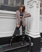 sweater,cardigan,black boots,ankle boots,leather pants,handbag,black bag,pearl,black crop top