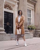 coat,beige coat,wool coat,white boots,ankle boots,heel boots,asymmetrical skirt,leopard print,midi skirt,white bag,bucket bag,white turtleneck top