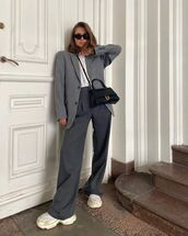 pants,grey pants,sneakers,grey blazer,black bag,white t-shirt