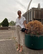 pants,high waisted pants,white sandals,white shirt,black bag
