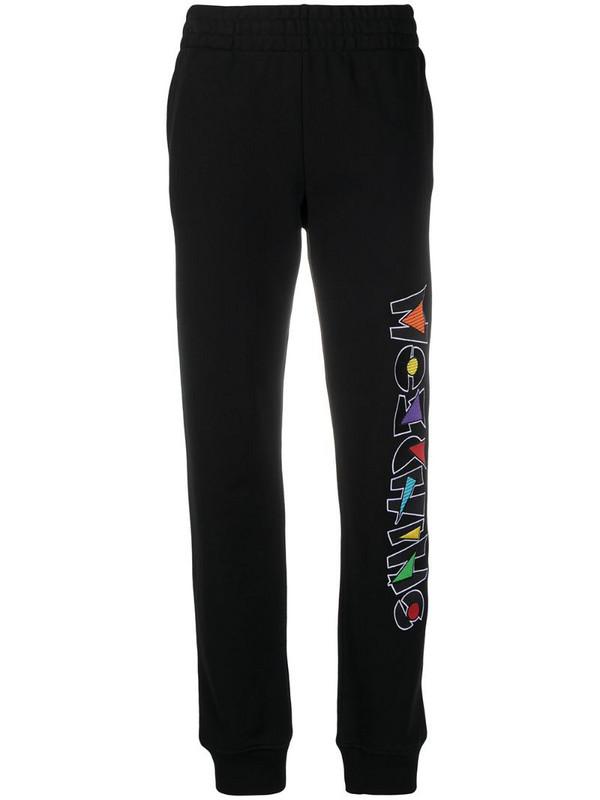 Moschino logo-print track pants in black