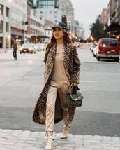 coat,long coat,leopard print,ankle boots,heel boots,silk,pants,black bag,handbag,knitted top,cap