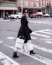 skirt,pleated skirt,white skirt,midi skirt,black boots,ankle boots,white bag,black coat,sunglasses