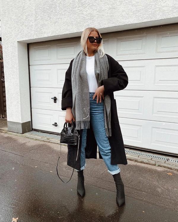 coat black coat long coat black boots sock boots high waisted jeans scarf white t-shirt