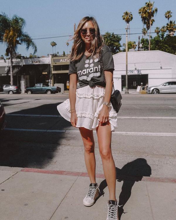top black t-shirt white shirt mini skirt white sneakers black bag