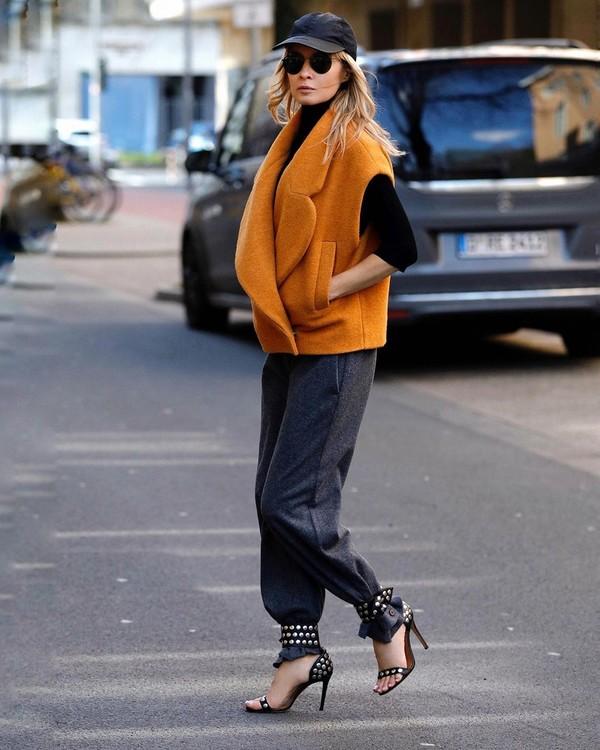 shoes black sandals straight pants grey pants vest black sweater cap