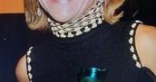 blouse,black sleeveless beige edge stitching