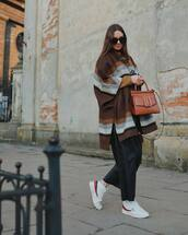 coat,poncho,stripes,wool,white sneakers,fila,black pants,leather pants,brown bag