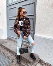 top,t-shirt,black t-shirt,calvin klein,mom jeans,ripped jeans,black boots,combat boots,black bag,chanel,black belt,plaid,jacket