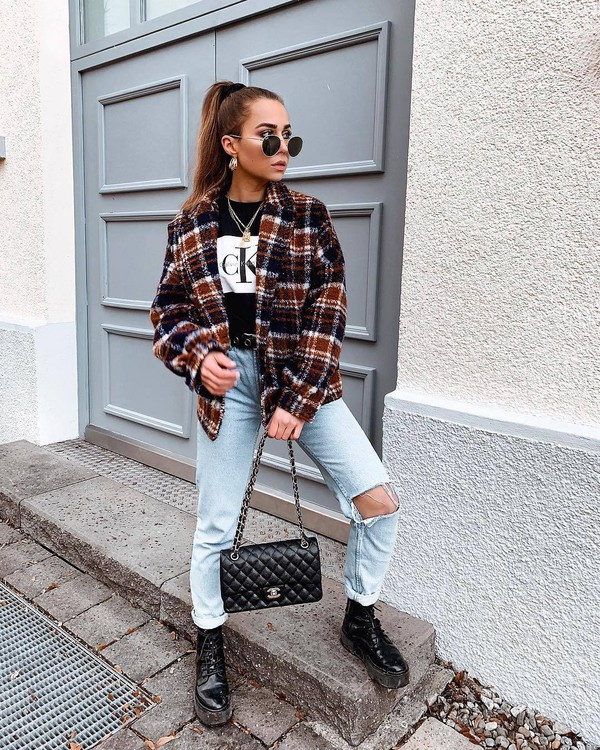 top t-shirt black t-shirt calvin klein mom jeans ripped jeans black boots combat boots black bag chanel black belt plaid jacket