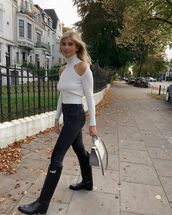 pants,black pants,skinny pants,knee high boots,black boots,turtleneck sweater,bag,white bag