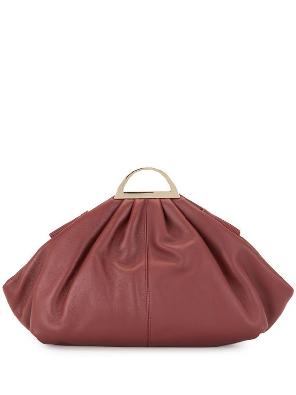 The Volon shell clutch bag in red