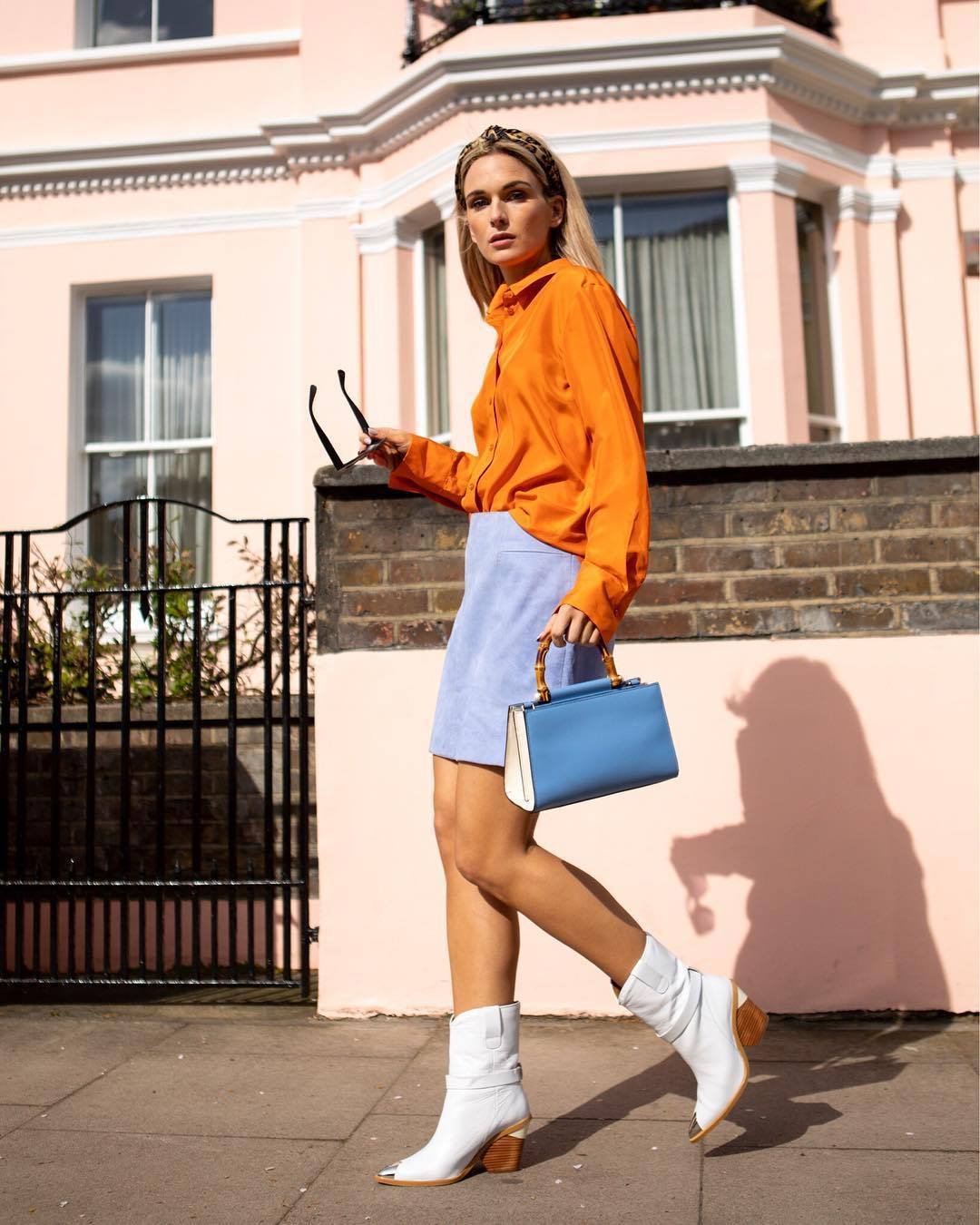 top shirt orange long sleeves white boots ankle boots mini skirt blue skirt handbag blue bag