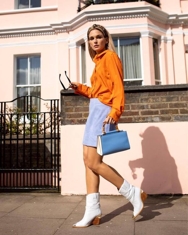 top shirt orange long sleeves white boots ankle boots mini skirt blue skirt handbag blue bag