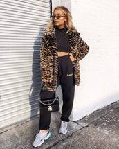 coat,faux fur coat,tiger print,black pants,sneakers,black bag,leather bag,cropped turtleneck