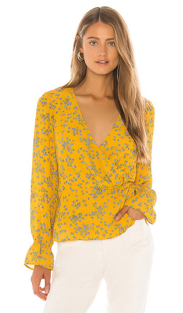 cupcakes and cashmere Joie Tossed Buds Wrap Blouse in Mustard