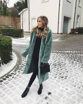 coat,faux fur coat,green coat,long coat,black boots,lace up boots,ankle boots,black leggings,black bag,black sweater,turtleneck sweater