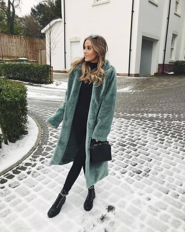 coat faux fur coat green coat long coat black boots lace up boots ankle boots black leggings black bag black sweater turtleneck sweater