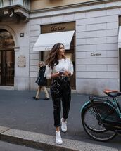 pants,black vinyl pants,white sneakers,white blouse