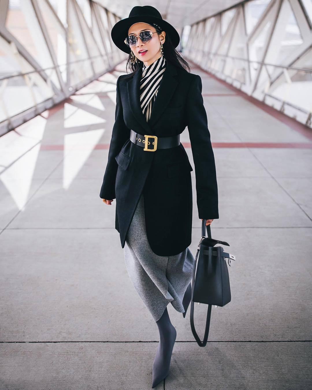 coat black coat black belt knitted skirt midi skirt sock boots shoulder bag striped top felt hat