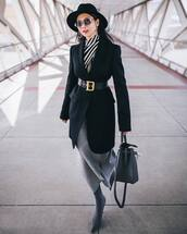 coat,black coat,black belt,knitted skirt,midi skirt,sock boots,shoulder bag,striped top,felt hat